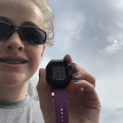 Freshman Madeleine Miller poses with her time in the 5K Challenge on May 1. One hundred and thirty students participated in the event which raised $1335.00 for the Mustang Strength and Speed program.