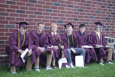 Luke Wade, Kode Banwart, Sam Adams, Graham Bradbury, Garrett Hormann, and Jack Kragenbrink sit behind the school after receiving their diplomas May 24.
